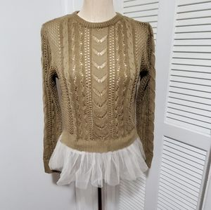 Flattering peplum style sweater with tulle detail